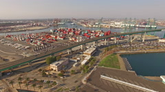 4K Aerial Hyperlapse view moving forward towards shipyard and freeway Stock Footage