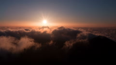 Brilliant summit dawn above flowing cloud waves, red sun disk time lapse in HDR Stock Footage