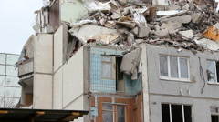 Demolition of building in urban environments with heavy machinery Stock Footage