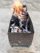 Burning wood in a brazier Stock Photos