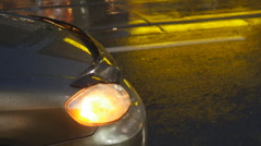 Parked car on rainy night. Hazard lights flashing. Stock Footage