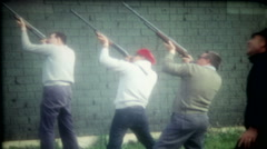 men take turns shooting clay birds with shotguns 3542-vintage film home movie Stock Footage