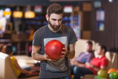 Man with bowling ball Stock Photos