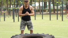 Sportsman working out his body in tire Stock Footage