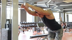 Young man doing exercises in a gym, workout Stock Footage