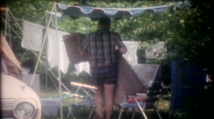 family campsite with friends next to beach 3543 -vintage film home movie Stock Footage