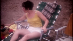 family & friends with the children at the beach 3544-vintage film home movie Stock Footage