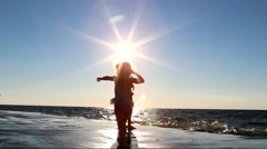 Silhouettes of people on beach at sunset on Lake Michigan, Holland, Mchigan Stock Footage