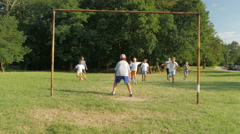 Kids Playing Football Or Soccer Match On The Green Field, Boy Giving Goal Stock Footage