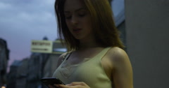 Texting woman on a smartphone device shot on RED Cinema Camera Stock Footage