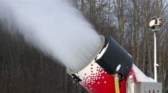 The powerful jet of artificial snow flies under pressure from the nozzles Stock Footage