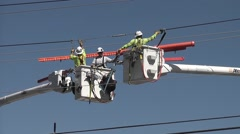 Linemen Remove Their Tools From Power Lines Stock Footage