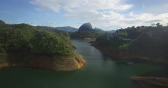 Beautiful aerial sailing towards the Piedra del Penol Stock Footage