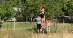 Family orchard picking fruit peach tree DCI 4K Stock Footage