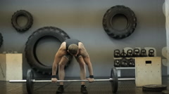 Young adult athletic man lifting a barbell during cross training at the gym Stock Footage