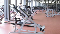 People are trained to walk on treadmill in large gym Stock Footage