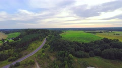 Forest and fields around small lake. Aerial.footage. Stock Footage