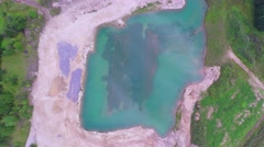 Flight over the small green lake. Aerial footage. Stock Footage