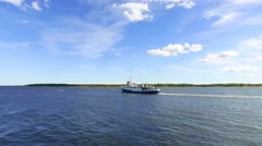 Passenger Boat Moving Away in Lake Stock Footage