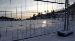 Artificial ice rink for a winter sky ride the fence on Stock Footage
