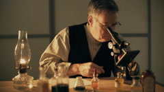 Turn of the century scientist looking at a chemical and taking notes 4k Stock Footage
