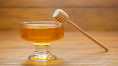 Honey is poured into a glass bowl (LR Pan) Stock Footage