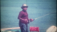young black boy fishing from the boat 3546-vintage film home movie Stock Footage