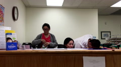 Motion of young people at work as receptionist inside BC medicial office Arkistovideo