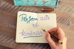 Handwritten text Perform Acts of Kindness Stock Photos