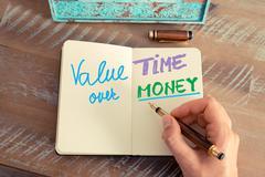 Handwritten text Value Time Over Money Stock Photos