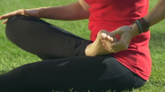 Woman practices yoga in the park Stock Footage
