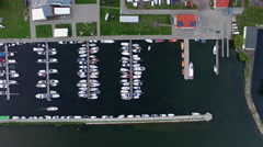 Aerial yachts in marina on lake vertical Stock Footage