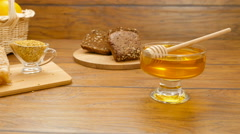 Composition of honey, honeycomb, fruits, bread and bee bread (LR Pan) Stock Footage