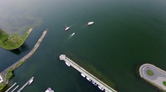 Aerial yachts in marina at dusk Stock Footage
