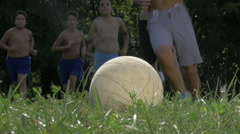 Playful Group Of Boys Run And Kick The Football Or Soccer Ball, Slow Motion Stock Footage