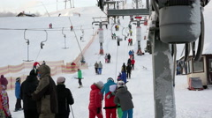 Work ski lifts to transport people on a steep trail to the top of the ski Stock Footage