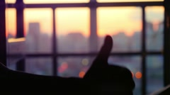 Concept of business. Silhouette hand gesture like against the evening blurred Stock Footage