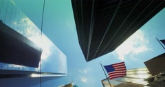 Tall Skyscrapers with American Flag Day Establishing Shot Stock Footage