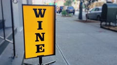 Spinning Wine Sign on Sidewalk Outside City Liquor Store Stock Footage