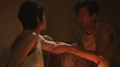 4K Drug addict couple in gloomy apartment, man injecting girlfriend in the arm Stock Footage