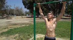 Fitness Man Doing Pull-Ups On Chin-Up Bar Stock Footage