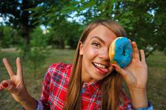 Merry girl and a donut Stock Photos