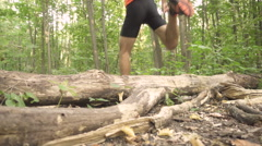 Man running cross country in summer forest. Jogging motivation in green park Stock Footage