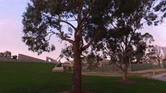 Tracking reveal of Australian Parliament House Canberra at dusk Stock Footage