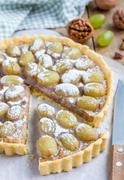 Homemade shortbread dough grape tart with walnut praline, vertical Stock Photos