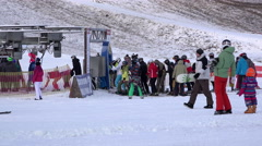 Children and adults engaged in winter sports in the ski lodge Riding Stock Footage