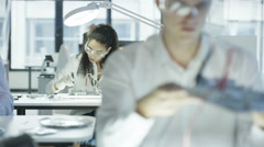 4K Electronics engineers working in lab building & testing motherboards Stock Footage