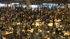 4k, Crowd of Muslims celebrate of Eid Al-Fitr in the Taipei main station. -Dan Stock Footage