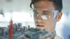 4K Close up electronics engineer working in lab building & testing motherboard.  Stock Footage