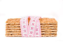 Diet Crispbread and measuring tape isolated Stock Photos